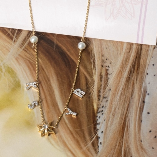 Family initial necklace in solid gold and diamonds
